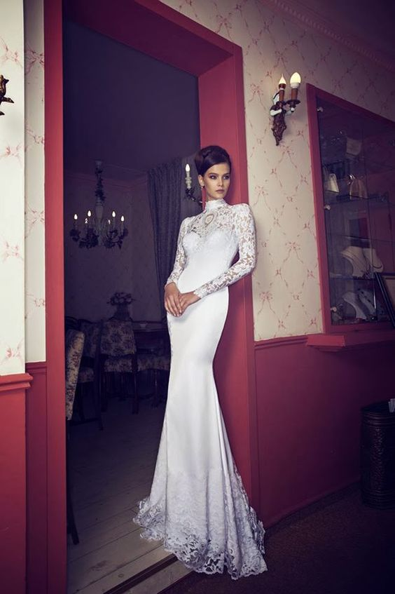 a romantic and modest wedding gown with a lace bodice, a high neckline and a lace trim on the skirt
