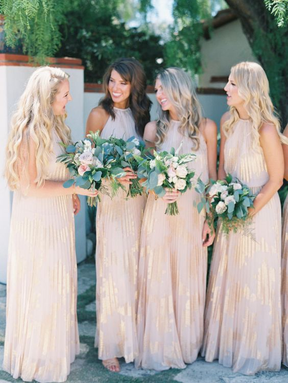 blush maxi pleated bridesmaid gowns with gold leaf detailing and halter necklines