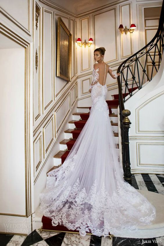 a sexy mermaid wedding gown with an illusion back, long sleeves and a cathedral train