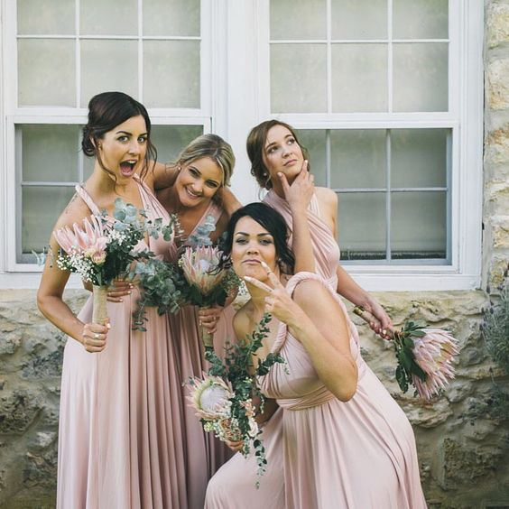 a pic of bridesmaids having fun before the wedding ceremony is priceless, forget all those traditional and boring portraits