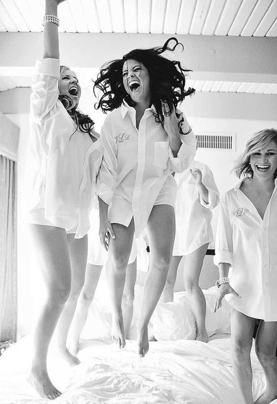 bridesmaids having fun before gettign ready for the ceremony - offer them the same shirts, rompers or robes