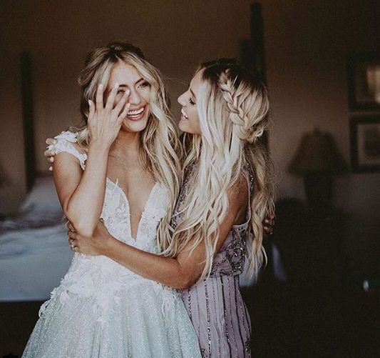 a sister bridesmaid and the bride having a moment before the wedding ceremony - you'll burst into tears