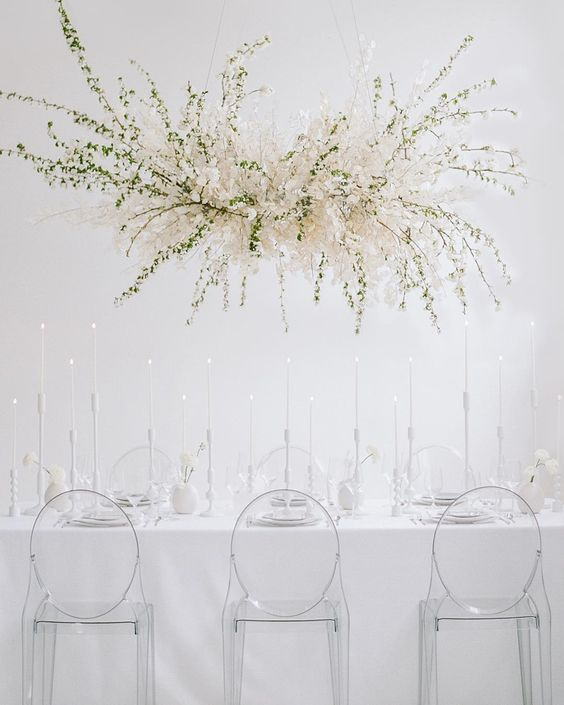 a fantastic overhead lunaria and greenery wedding installation will highlight your reception