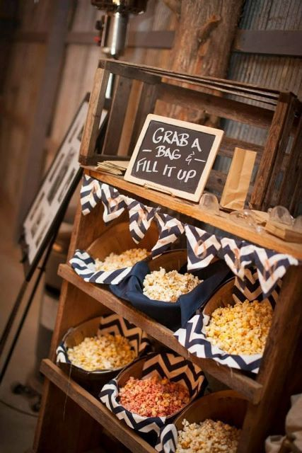 a small popcorn bar with chevron covered baskets is a cool idea of a late night snack