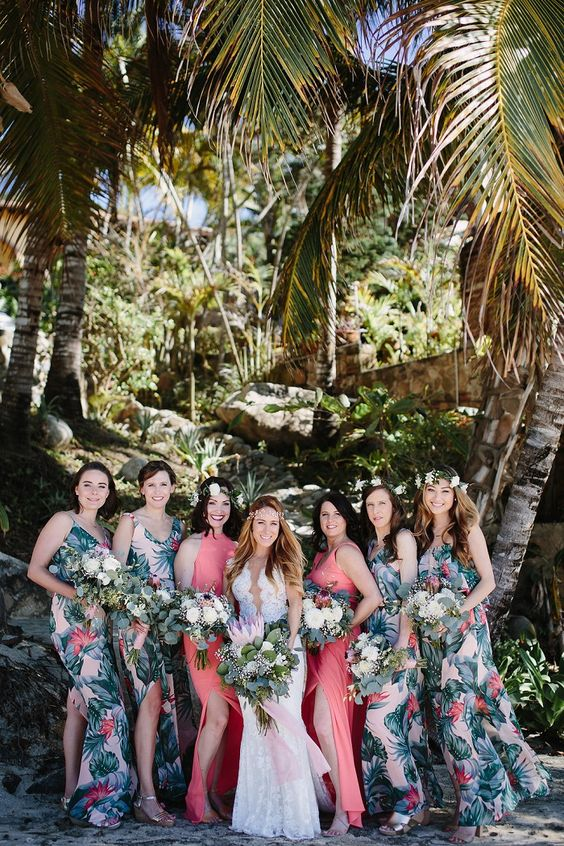 bold tropical print bridesmaids' dresses with side slits and bright coral maxi gowns with side slits for the maids of honor