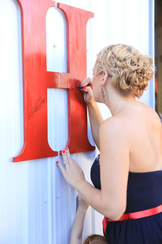 have the guests sign the first letter of your last name instead of a usual wedidng guest book