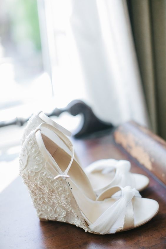 white wedding wedges with a lace embellished back and thin straps on the front