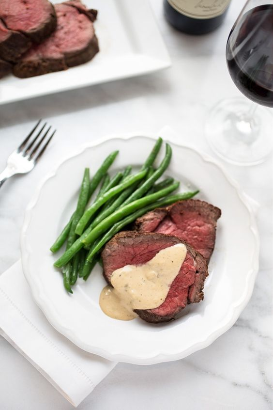beef tenderloin with cognac cream sauce, shallots and thyme and fresh asparagus as a garnish