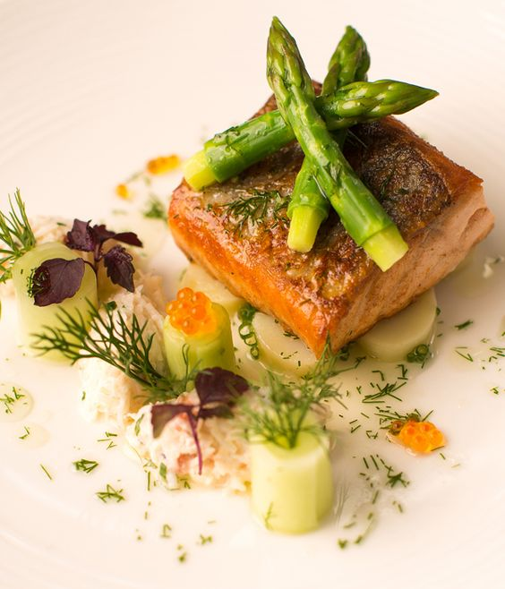 pan-roasted fillet of slamon with dill and crab salad, asparagus and cucumbers