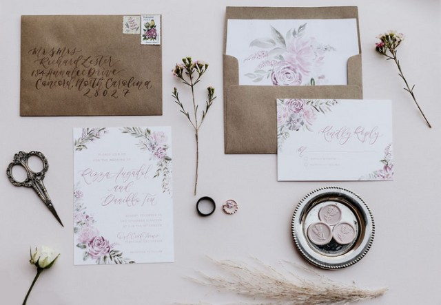 The wedding stationery was simple, with kraft paper envelopes, floral painted invites