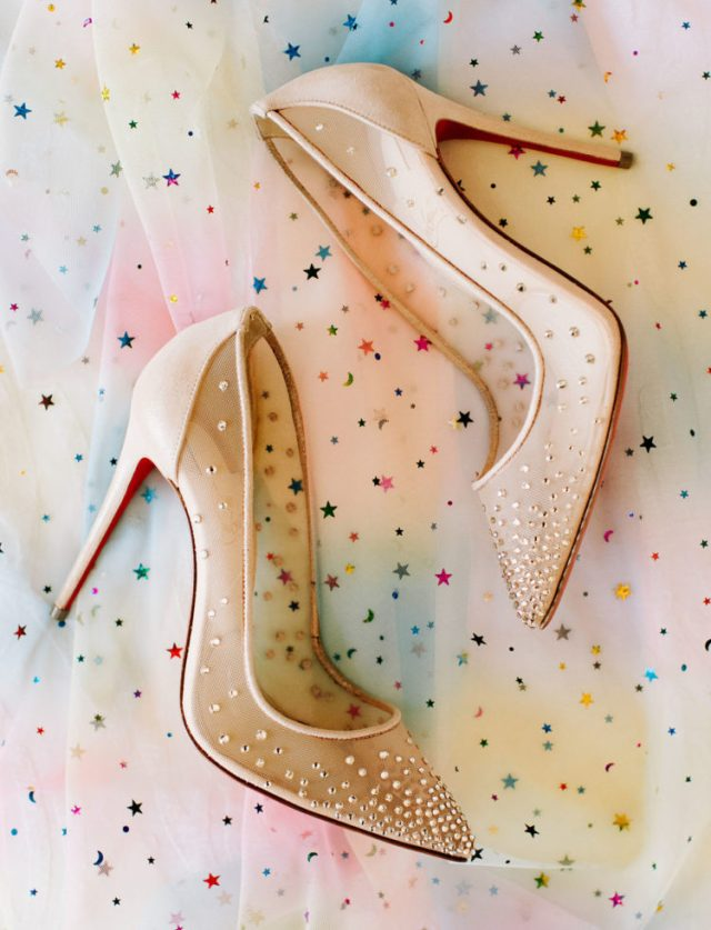 Her pumps were nude sheer ones with embellishments for a glam touch
