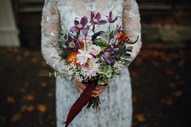 The bridal bouquet was bright and textural, in lilac, orange, blush and green