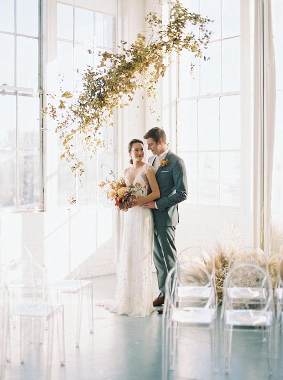 a gorgeous gilded foliage wedding installation is a great wedding ceremony backdrop