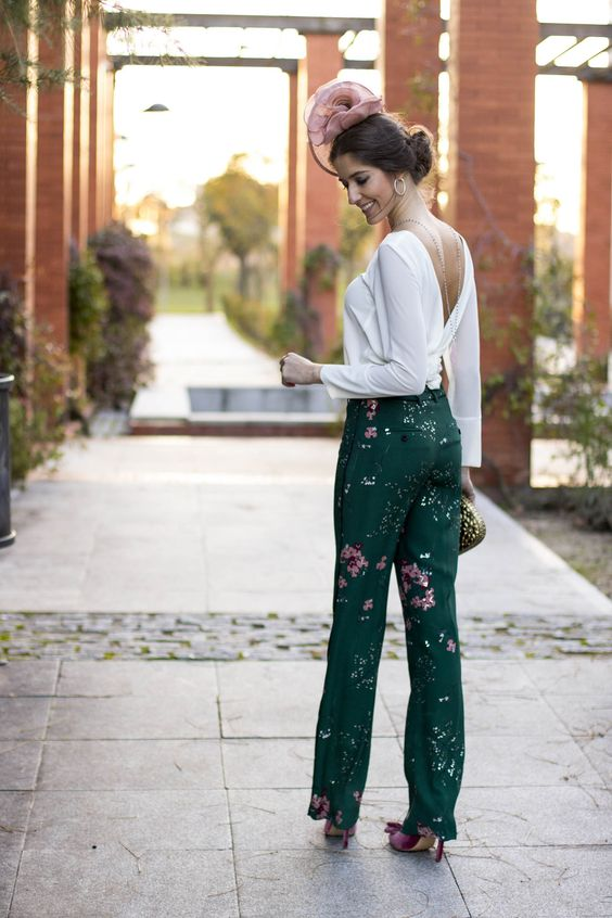 dark green floral pants, a white blouse with a cutout back, a back necklace, a metallic clutch and fuchsia shoes