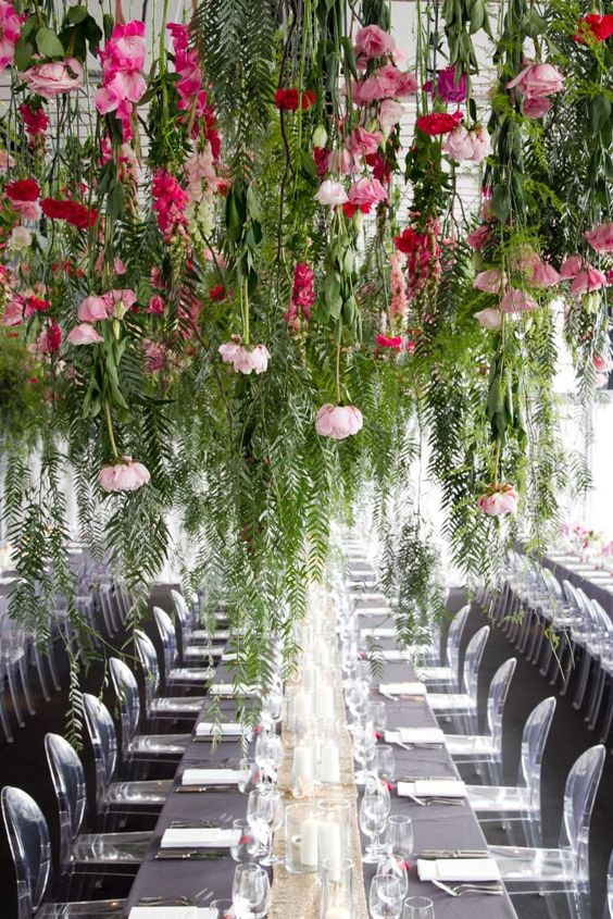 keep your reception clutter-free creating such lush greenery and pink bloom installations over the tables