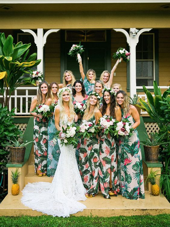 mismatching bold tropical print maxi dresses are great for a 70s tropical wedding
