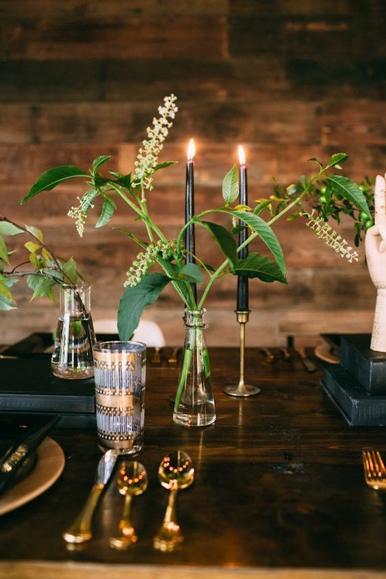 clear vases with greenery and black candles create a chic look with a minimalist feel - nothing unnecessary here
