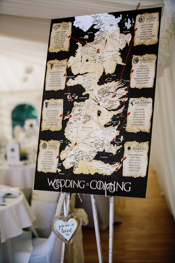 a wedding seating chart with traditional prints and the map of the GOTH world is a gorgeous idea