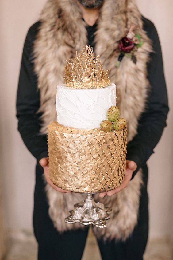 a chic GOTH wedding cake with gold scale, a white textural tier and a gold crown on top plus edible dragon eggs