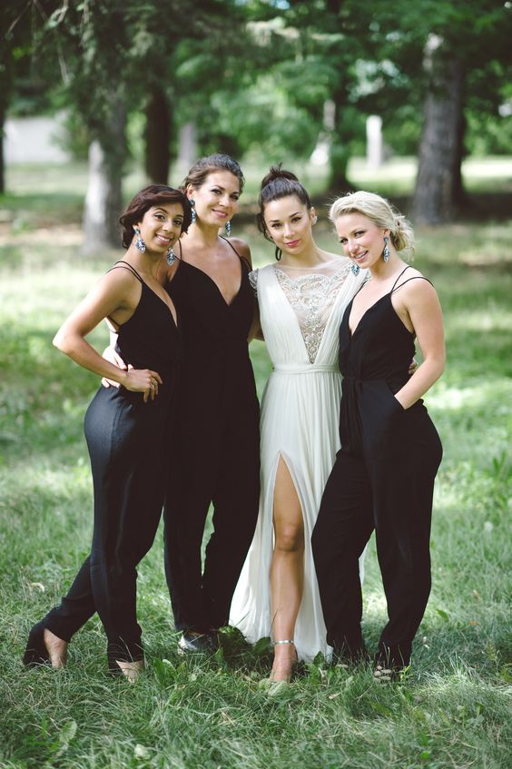 sexy black bridesmaid jumpsuits with spaghetti straps and deep V-necklines plus black shoes