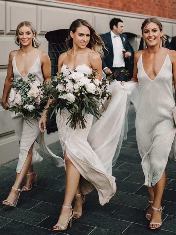 gorgeous embellished white bridesmaid slip dresses with side slits and nude shoes