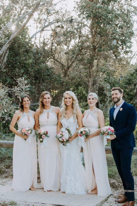 glam light pink maxi halter neckline bridesmaid dresses with cutouts and glam sparkly touches