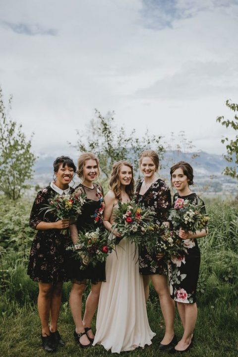 cool mismatching dark floral bridesmaid dresses of various lengths and looks