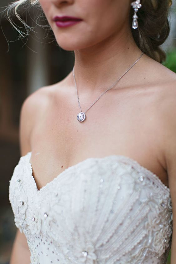 a beautiful vintage statement crystal necklace to highlight the sweetheart neckline and embellished bodice