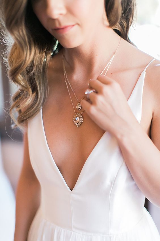 a double vintage inspired crystal drop necklace with yellow diamonds to highlight the plunging neckline of the dress