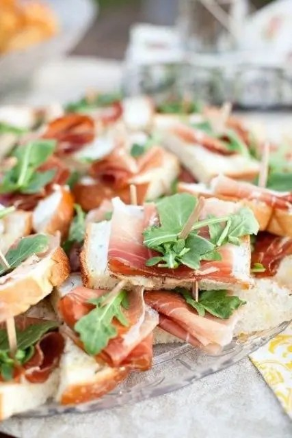 tasty sandwiches with prosciutto and fresh arugula are a gorgeous snack idea