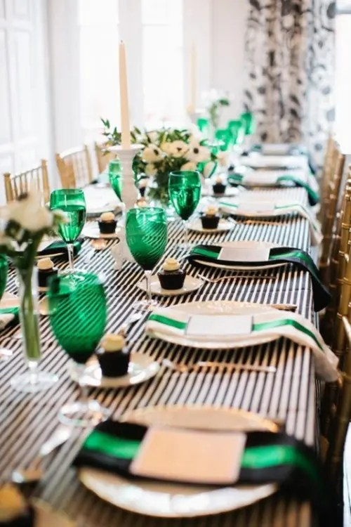 emerald glasses and black and emerald napkins add color to this monochromatic table setting