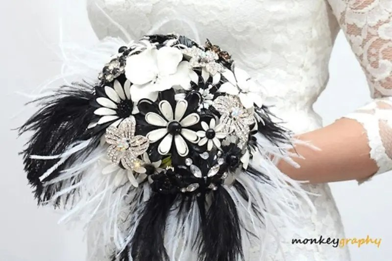 Picture Of A Brooch, Feather And Paper Flower Wedding