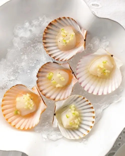 scallops with some condiments are amazign for sea food lovers or for beach and coastal weddings