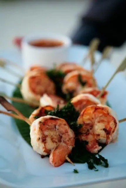 grilled shrimps on skewers with fresh greenery will be loved by most of guests, they are delicious