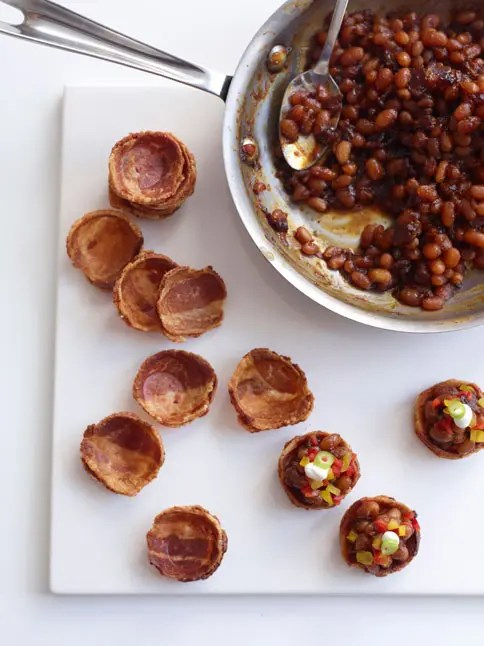 bacon cups fileld with beans, pepper and greenery on top