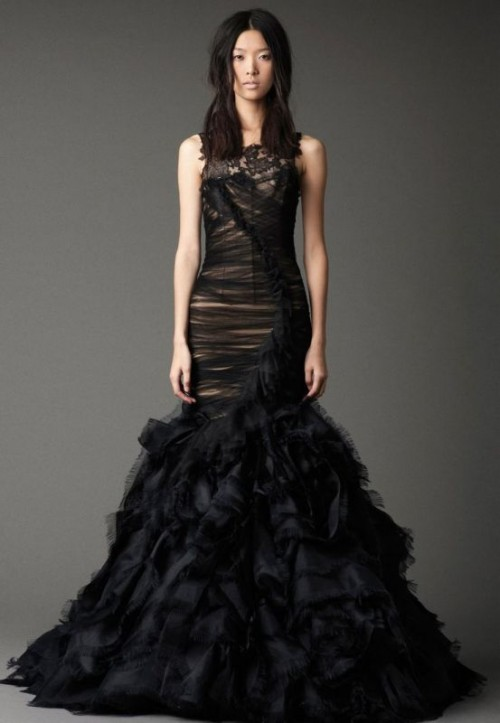 a black mermaid wedding dress with no sleeves and a wrapping effect for a soft gothic bride
