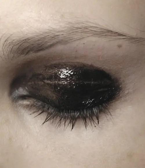 black glossy smokey eyes for a soft gothic bride