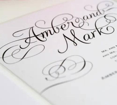 elegant white wedding stationery with black calligraphy for a soft gothic wedding
