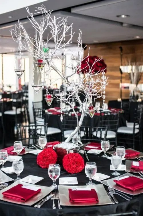 a black and red wedding tablescape with silver touches and a whitewashed tree with crystals hanging