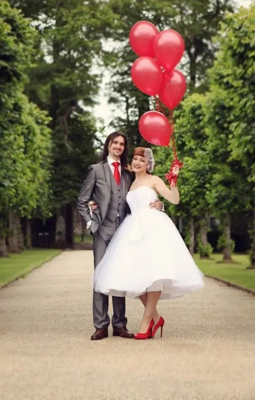 touches of red - red balloons, a red tie and shoes will give a bold touch to your look