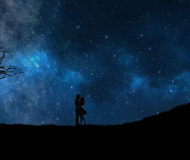 Silhouette Of Man And Woman Under The Starry Night