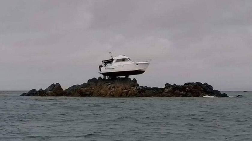 Boat runs aground on rock three meters above sea on Jersey Island