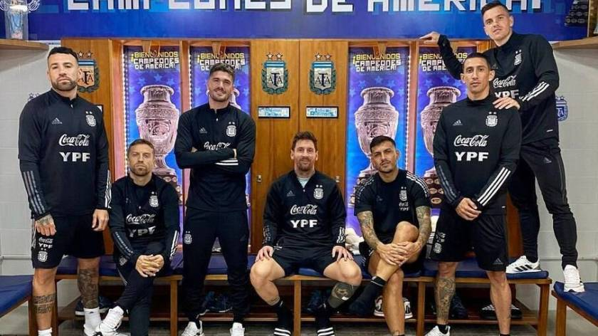 Argentine players pose for a photo in the locker room and reminisce about winning the Copa América over Brazil