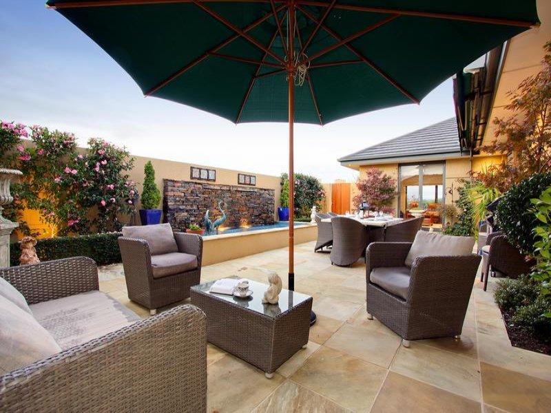 Indoor-outdoor outdoor living design with spa & rockery ... on Outdoor Living Spa id=18755