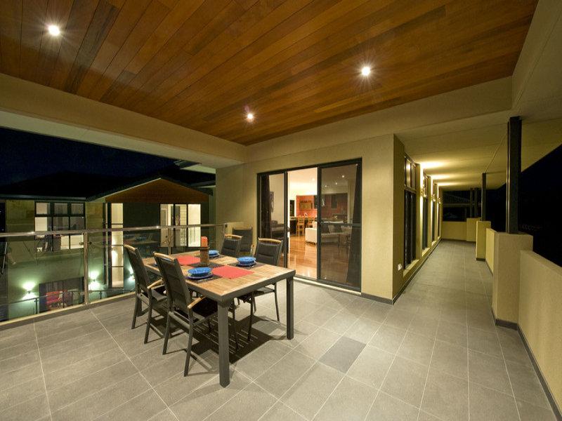 Indoor-outdoor outdoor living design with glass balustrade ... on Fancy Outdoor Living id=55714