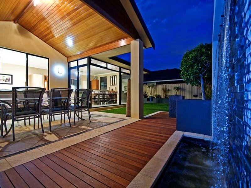Walled outdoor living design with deck & decorative ... on Fancy Outdoor Living id=12178
