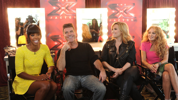 'X Factor' USA judges Kelly Rowland, Simon Cowell, Demi Lovato and Paulina Rubio at a press conference