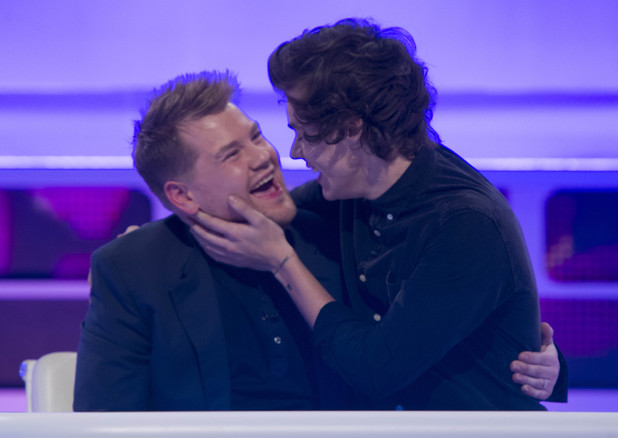 Harry Styles and James Corden when they reenact the 'kiss cam'.