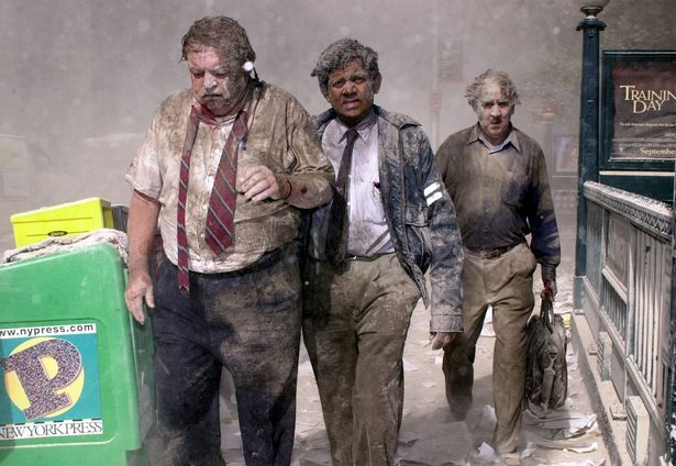 George Sleigh, originally from Gateshead, on the far right, walking away after the 2001 terror attack on New York's World Trade Centre  nine/11 assaults: The Gateshead guy who survived Global Industry Centre carnage JS99017301