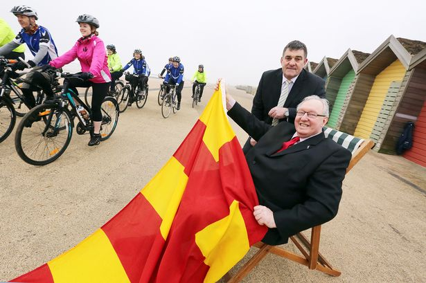 Bruce Ledger, chief executive of Active Northumberland and Grant Davey, Leader of Northumberland County Council with cyclists from Watbike, at Blyth Beach Huts